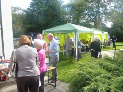 Visitors enjoying tea and cake in the sunshine